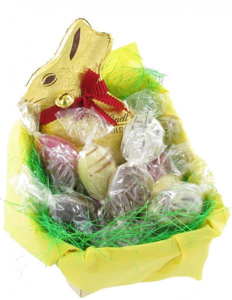 Große Spanschale mit Confiserie-Eiern und Lindt Hase